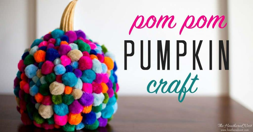 This is the CUTEST pumpkin craft I've seen!! LOVE this DIY pom pom craft for fall! Pom poms are so popular right now! Trying this easy DIY pumpkin project this fall for sure!!