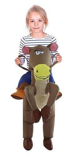 A person wearing an inflatable horse rider costume