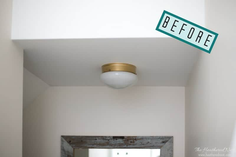 Unbelievable...and what a great idea for renters, too! Try this 5-minute, NO TOOLS needed boob light makeover using a candle lantern from the Heathered Nest!