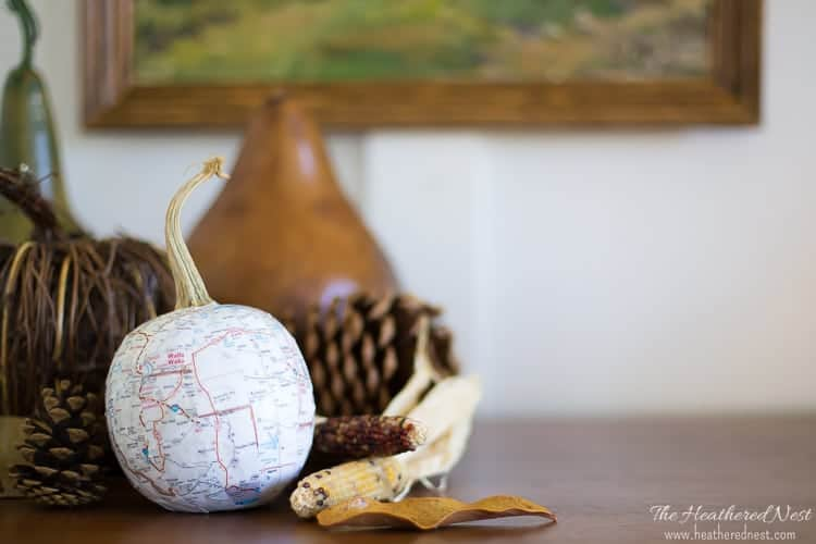 Easy pumpkin DIY project using maps! Gives them such a nice, neutral look. Fun #pumpkin #craft idea for #fall from heatherednest.com