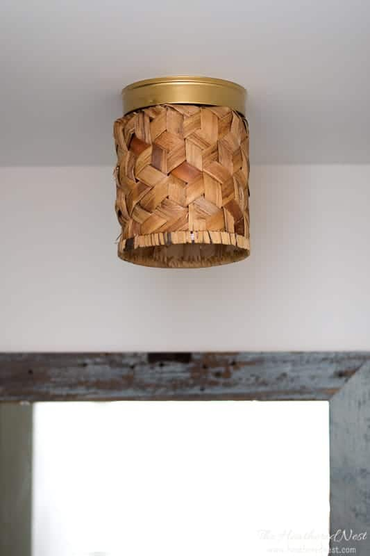 Conquer the Ceiling Cleavage! You can banish those ugly flushmount light fixtures in minutes with these simple DIY ceiling light covers made from a basket #DIY #lighting #booblights #flushmount #booblightideas #prettyflushmountlighting #DIYlighting