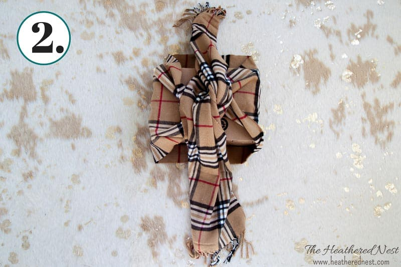 winter scarf being wrapped around a box