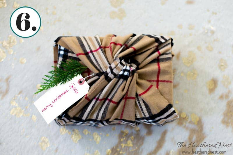 gift wrapped in a winter scarf as an alternative to disposable wrapping paper