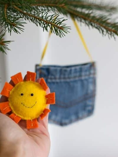 "Got a JT fan at home? They'll love this adorable DIY ornament! Make a little ""sunshine in my pocket"" and give it away! Felt ornaments are the cutest. And easy to make, too! #feltornaments #sunshineornament #sunshineinmypocket #DIYornament #easyornament #feltornaments #sunshineornament"
