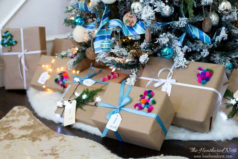 you wont believe the trick to making this christmas gift wrap with pom poms