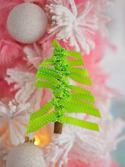 Here's a cute DIY Christmas ornament to try! A Christmas tree from a cinnamon stick + ribbon! #stickcraft #cinnamonornaments #DIYchristmastreeornaments #ribbonchristmastreeornament