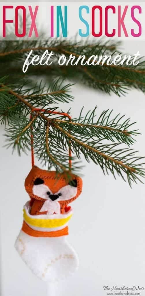 "Such a fun DIY ornament! Check out our ""fox in socks"" Christmas ornament!! An adorable felt ornament to grace your tree this year, and for years to come. This little fox ornament can be removed from his little stocking any time someone wants to give him a squeeze. #foxornament #easyfeltornament #DIYfeltornament #animalornament #foxinsocks"
