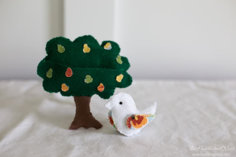 Make this sweet 12 days of Christmas partridge in a pear tree felt ornament! Adorable. The bird is removable from the tree. #12daysofchristmas #christmasornamentideas #partridgeinapeartree #12daysofchristmasornaments #DIYchristmasornaments #feltornaments