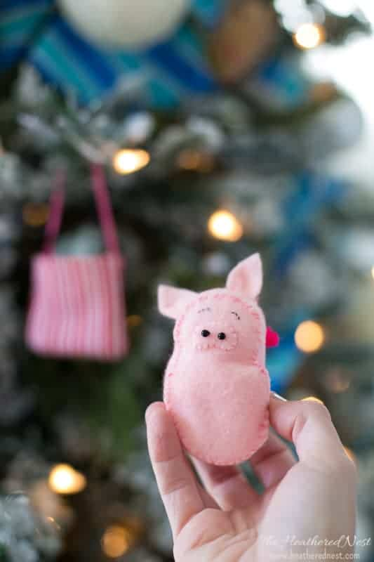"Precious ""Pig in a blanket"" DIY felt pig ornament. The pig is removable from it's blanket. Super cute pig ornament for Christmas!! #pig #feltornaments #pigornament #feltchristmasornaments #animalornaments #DIYornaments #easyfeltornaments #feltornamentsforkids"
