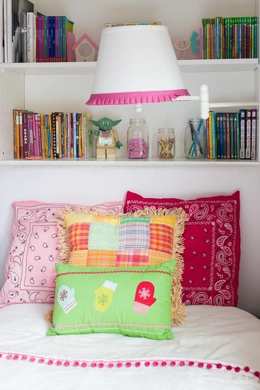DIY pillow cover tutorial. Made from one dollar store bandanas! Adds fun, color & pattern to any space, indoor or out! #bandanaDIY #bandanadecor #bandanacrafts #bandanaprojects #bandanaideas