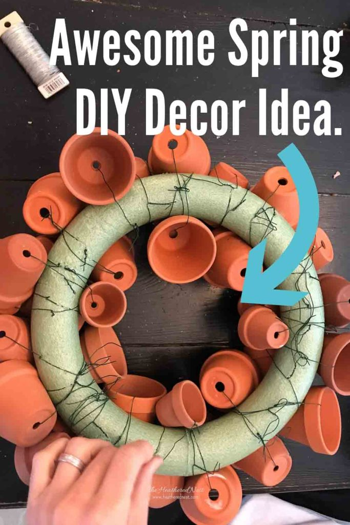 Check Out This Awesome Spring Decorating DIY Project That You Can Make For Your Home. This DIY Craft Project Requires 3 Supplies. #springdecorideas #spring #springdecoratingideas #springDIYproject #springwreath #springwreaths #DIYwreath #DIYspringwreath #terracotta #ClayPotCrafts #ClayPotWreath #ClayPotCraftIdeas