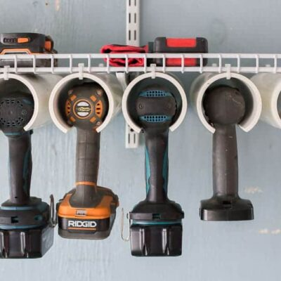 A quick & easy DIY power tool organizer you can make in 2 hours or less. And space to store those chargers and cords, too. Made from an inexpensive wire shelf and PVC pipe. A simple & versatile way to store tools. #toolorganizer #powertools #garageorganization #toolorganizerDIY #toolorganizergarage #toolorganizerideas #garageorganizationDIY #garageorganizationideas