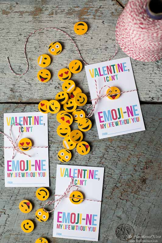 free printable emoji valentines on a rustic wood surface