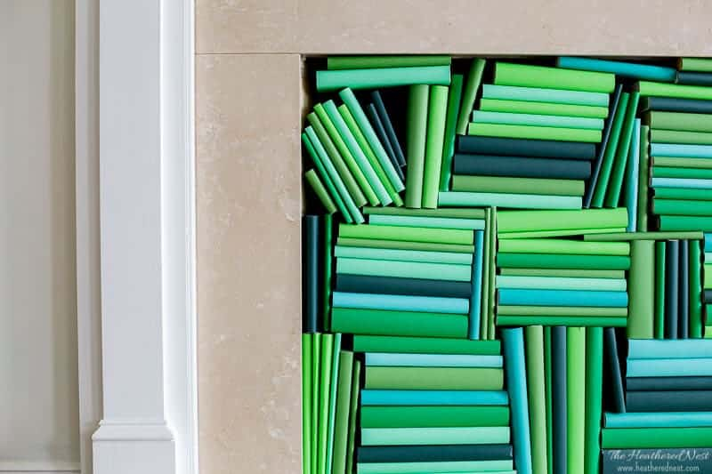 Easy DIY book cover tutorial. Takes about 30 seconds/book, and you can put together an ombre book display anywhere in your own home! #ombre #bookdisplays #bookdisplayideas #ombrebookcovers #green