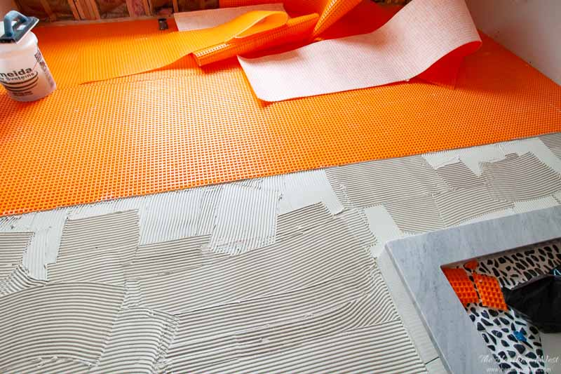 Having a proper subfloor underlayment material is vital for making sure your new tile installation doesn't end up cracked and damaged! This is why we chose the Schluter Ditra XL for our tile flooring project #SchluterDitra #SchluterSystems #subfloorideasDIY #tileinstallationtips #tileinstallationDIY #tileunderlayment #underlaymentproducts #SchluterDitraXL