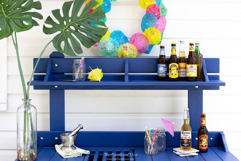 This easy DIY summer wreath can be made in minutes! These door wreaths are inexpensive to make add such a fun pop of color to any summer party! #cocktailumbrellawreath #DIYsummerwreath #doorwreaths #easywreathideas #DIYwreath #summerwreath #summerpartyideas #summerpartywreath