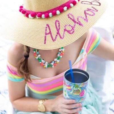 Add a pop of color and fun to your floppy wide brim beach hat this summer with pom pom trim, or fringe! It will take less than 5 minutes! #beachhat #pompomtrim #widebrimhat #floppyhat #embellishedhat #beachhatDIYsummer #beachhatDIYfun #pompomcrafts