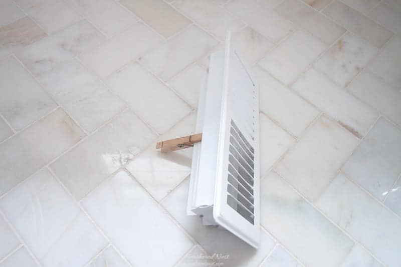 house staging tips: bad smells kill real estate deals. Make sure your home smells like a place people want to be! Image of clothespin and vent cover used for one of our favorite scentscaping hacks for home!