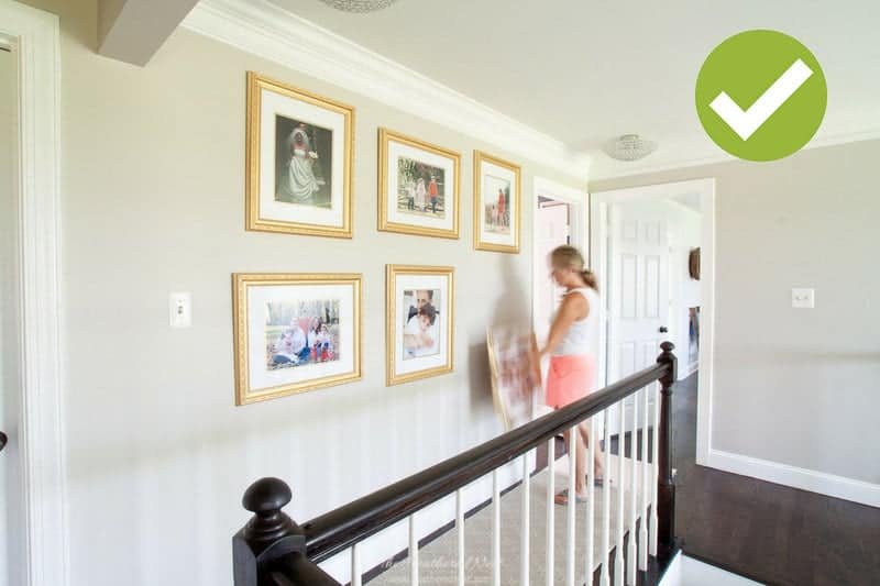house staging tips: image of depersonalizing artwork. take down family pictures and diplomas. replace with artwork or images that anyone can relate to.