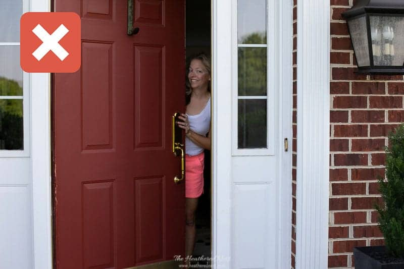 house staging tips: DON'T be home while buyers tour! Image of homeowner opening front door.