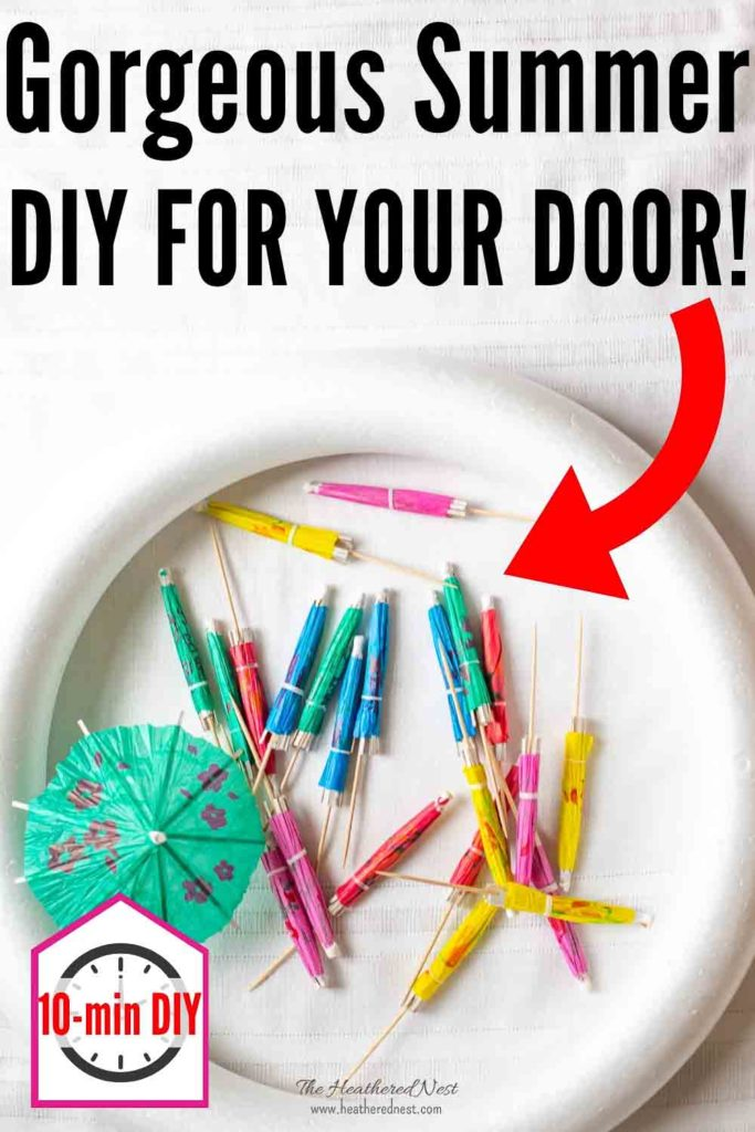 Done in 10-minutes. Check out how flipping cute this inexpensive DIY summer wreath is!!! #DIYsummerwreath #summerwreathideas #summerdoordecorideas #summerdoorwreath #cocktailumbrellawreath #DIYumbrellawreath #DIYcocktailumbrellawreath #cocktailumbrellas #cocktailumbrellacrafts