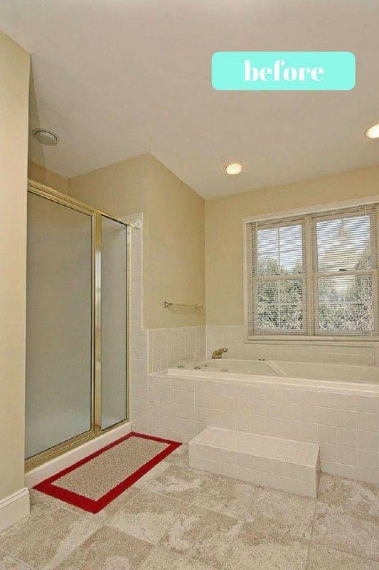 old shower prior to master bathroom renovation. Old brass framed shower before installing new frameless glass walk in shower enclosure