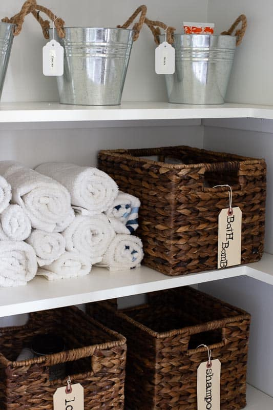 inside linen closet of grey bathroom renovation