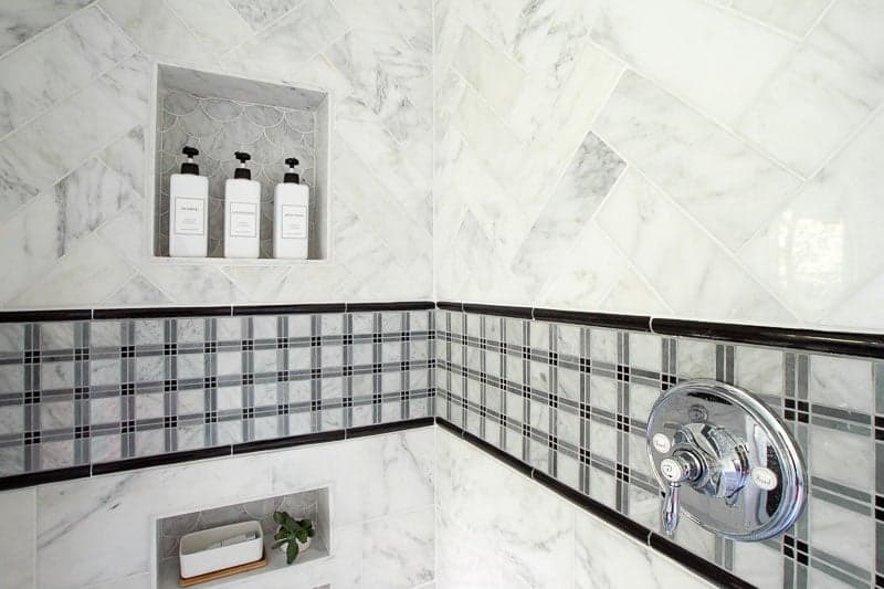 marble subway tile from the builder depot and tartan plaid accent tile in grey bathroom renovation