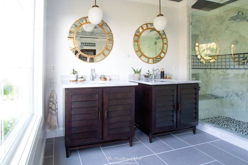 Check out this GORGEOUS #masterbathroom #renovation !! AMAZING from top to bottom. The #wallpaperedceiling the huge #picturewindows #modern #vesseltub #vintagedoor #walkinshower with #dulashowerheads ?! I'm in ❤️w/ this grey bathroom !! #doubleshowerheads #greybathroom #blackandwhitebathroom #masterbathroomideas #masterbathroomrenovation #DIY #fabriclooktile #greytile #graybathroom #luxurybathroomideas #cloudwallpaper #cole&son #coleandsonwallpaper #moen #miseno #featherlights #featherlighting
