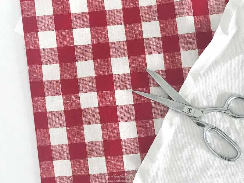 Buffalo Plaid placemat / Gingham placemat used for DIY red clutch shown with fabric scissors and white denim used for liner