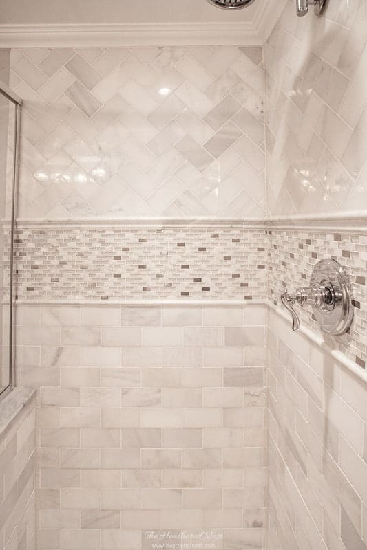 subway tile patterns glossary post - herringbone on top, chair rail below, accent tile, pencil rail, then running bond tile patterns from top to bottom