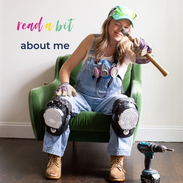 heathered nest owner, heather thibodeau wearing overalls, kneepads, holding hammer seated in green velvet chair. text overlay, read a bit about me