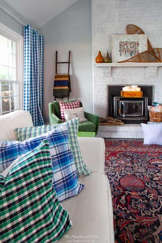 fall family room makeover with gingham blue curatins, recycled shirt DIY plaid pillows, hudson-style blanket and vintage area rug