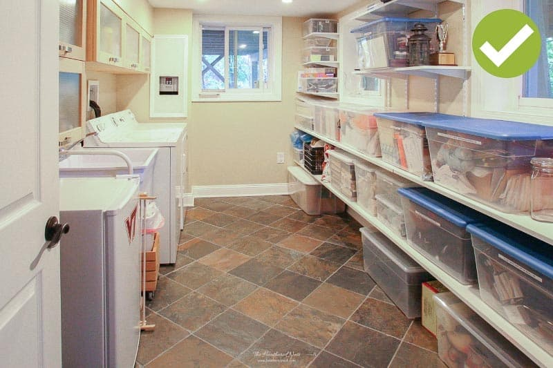 Organized clear plastic bins in a storage area. How to declutter your home when preparing to sell. 5 tips.