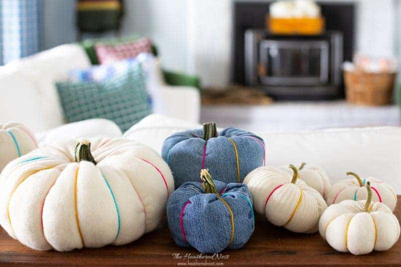 patch of fabric DIY pumpkins from old jeans, scrap fabric, old sweaters. tutorials from heathered nest.