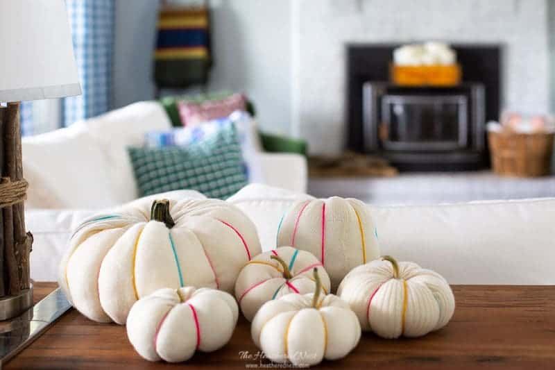 You can make scrap fabric pumpkins in 3-min, or about 20 w/the spines! Full tutorial & perfect for almost any fabric scrap!! Such a fun fall craft to try this autumn & Halloween! #fabricpumpkin #fabricpumpkins #DIYpumpkinidea #DIY #DIYpumpkincraftidea #pumpkincraft #sweaterpumpkin #upcycledpumpkin #scrapfabricideas #oldsweaterpumpkin #howtomakeafabricpumpkin #DIYstuffedpumpkin #easyfallcraft #easyfallcraftideas #easypumpkincraft #nocarvepumpkinideas #nocarvepumpkinidea #pumpkin #pumpkins