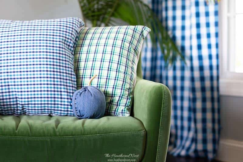 easy DIY denim pumpkin tutorial. how to make a fabric pumpkin with or without spines. Sitting next to upcycled plaid shirt pillows.