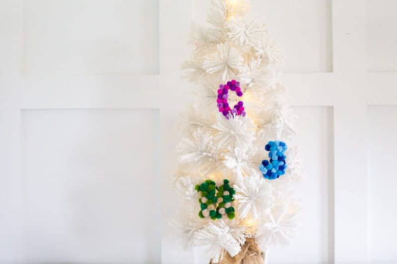 Learn how to make these quick & easy DIY pom pom letter ornaments! These colorful Christmas ornaments take less than 10-min to complete & will add color & fun to your Christmas tree over the holidays! #letterornaments #monogramornaments #DIYchristmasornaments #easyornamentideas #pompomornamentideas #pompoms #monogramideas #DIYornaments #pompomcrafts