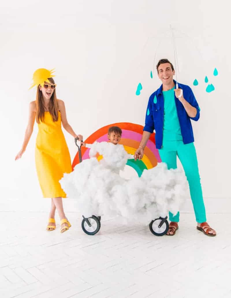 mom dressed as sunshine, dad as rain, baby in wagon with poly-fill to create cloud for last minute halloween costume