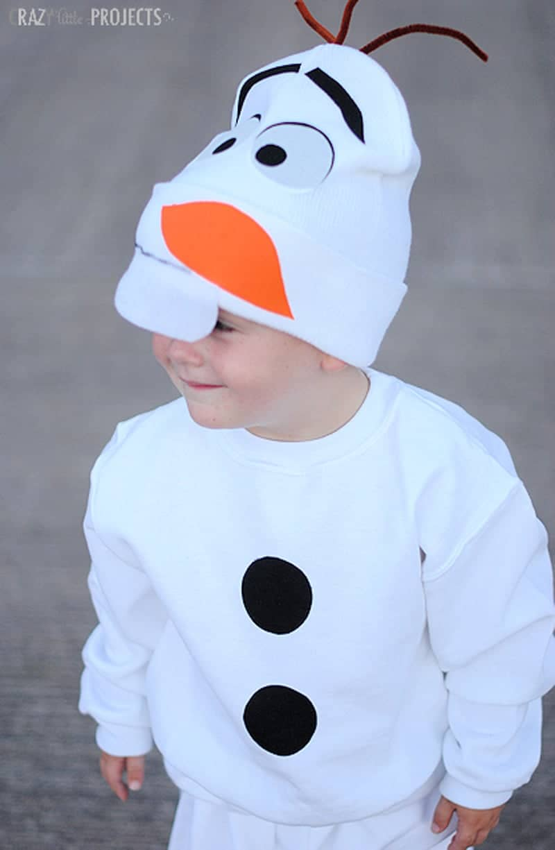 little boy wearing Olaf snowman hat and sweatshirt with two round circles last minute halloween costume
