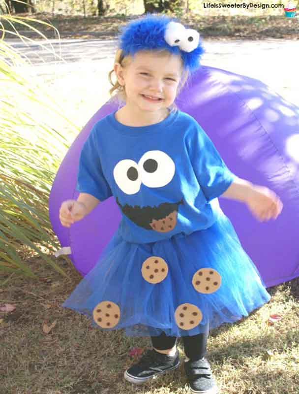 little girl in cookie monster costume with blue skirt and t-shirt