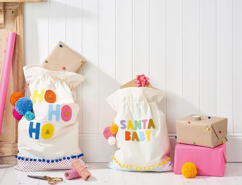 pom pom and felt embellished Santa bags