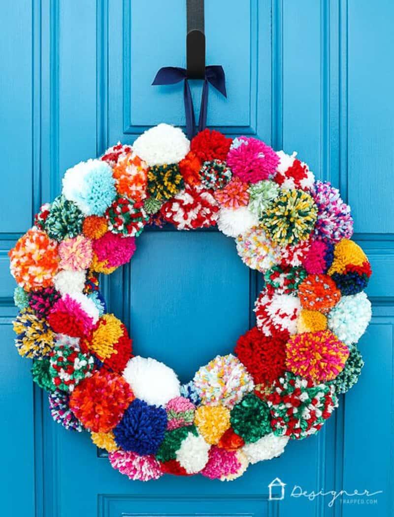 pom pom wreath on a blue door