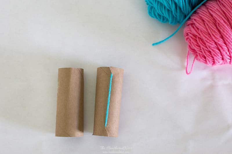 Image of trick described for the easier method for how to make pom poms with toilet paper rolls