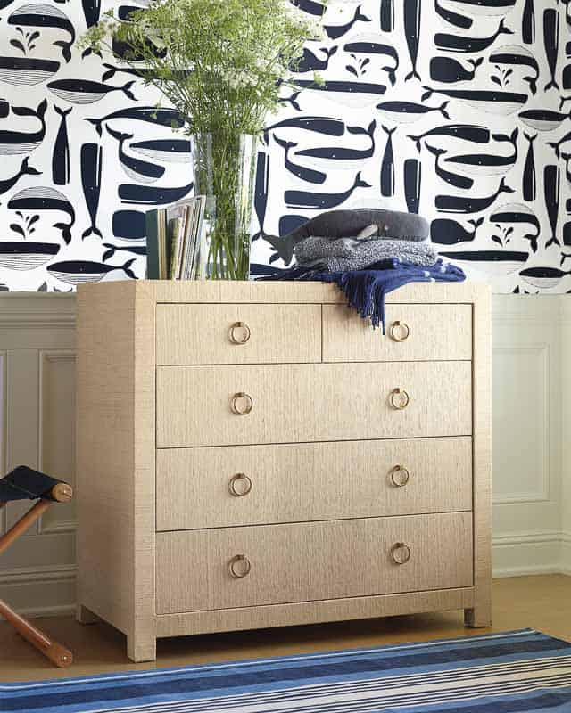 beachy dresser with blue striped coastal vibe rug and preppy wall wallpaper from Serena & Lily in a nautical nursery