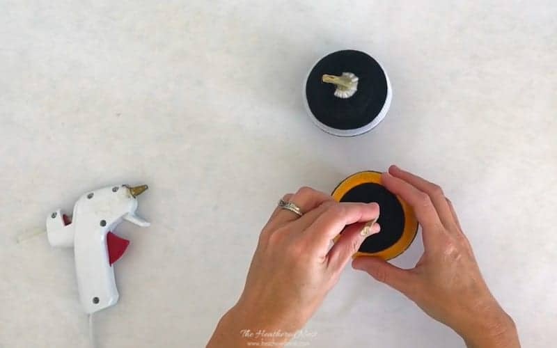 hot glue real pumpkin stem to fabric pumpkin. Great fall craft for kids! No sewing required. Make these 5-minute pumpkins from socks! #DIY #pumpkins #socks #nosew #fallcraft #craftsforkids #sockpumpkin #sockcraft #oldsocks #usedsocks #popularpumpkinideas #fabricpumpkins #howtomakefabricpumpkins #upcycle #reuse #repurpose ##DIYpumpkin #DIYfallcraft