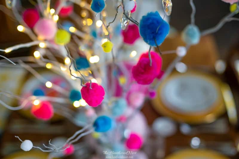 close up of DIY pom pom branches mixed with lit birch branches