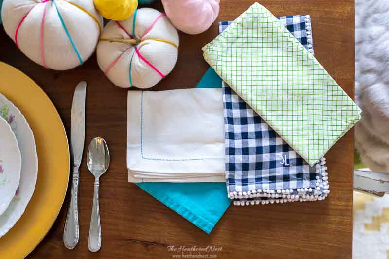 closeup of mix and match napkins for a colorful thanksgiving tablescape