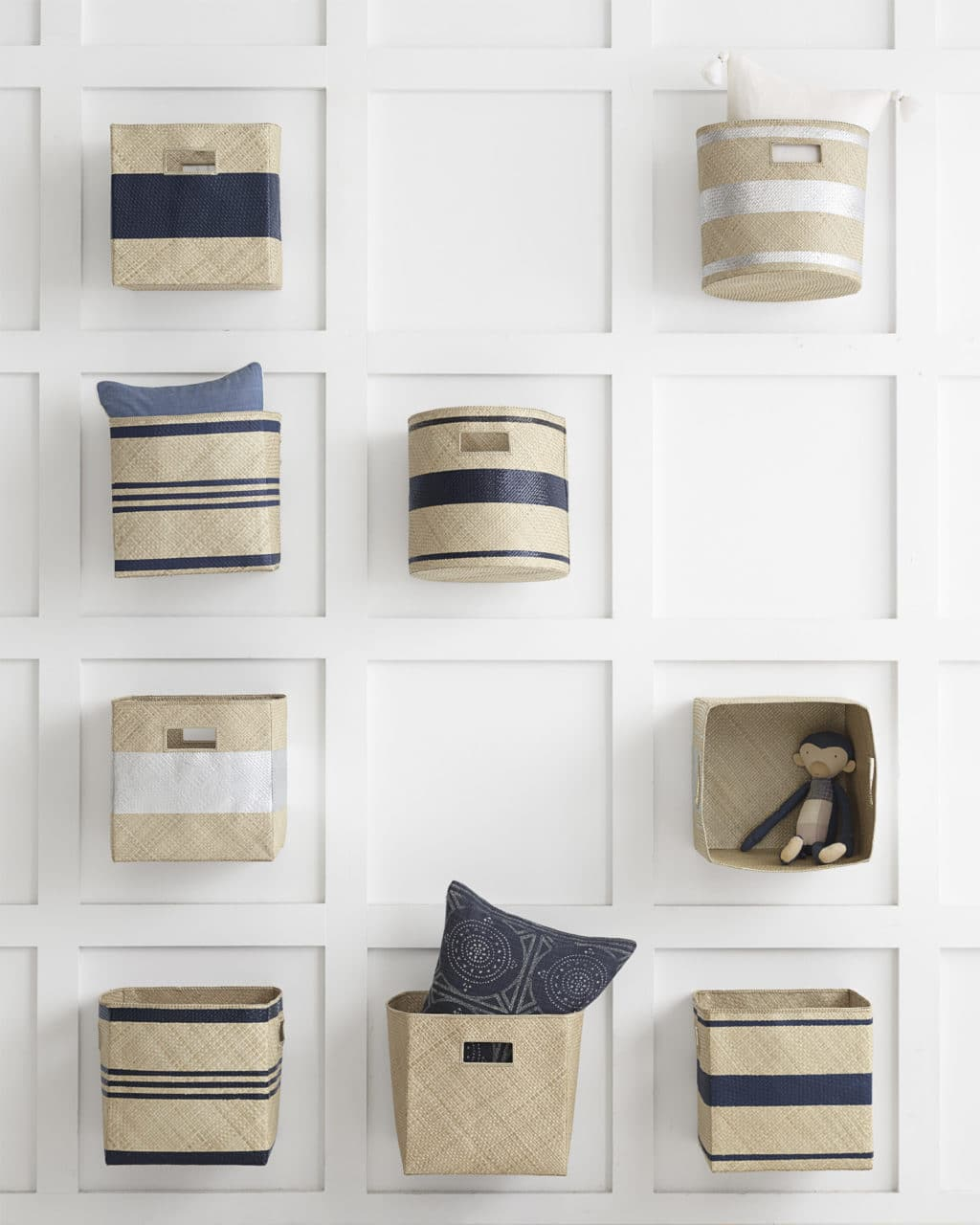 feature wall created with hanging coastal inspired bins from Serena & Lily