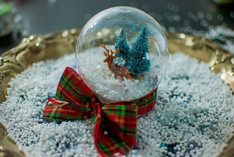 white christmas snowglobe with reindeer and mini trees